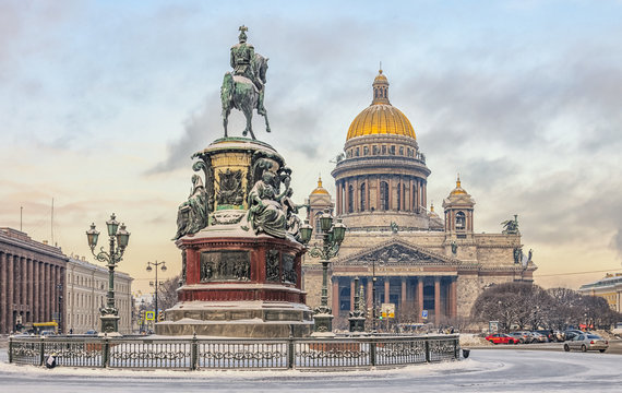 A view of Isaac square with The Monument to Nicholas I and St.Isaac Cathedral at a snowy winter day