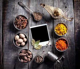 Spices and blank photo at the table