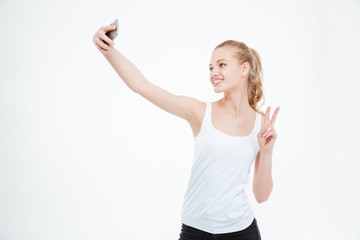 Smiling woman taking selfie photo on smartphone