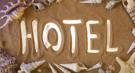 Hotel symbol in the sand. Beach background. Top view