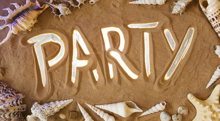 Party symbol in the sand. Beach background. Top view