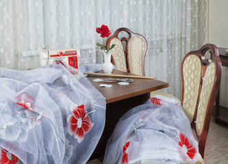 workplace оf seamstress or designer with sewing machine and lux