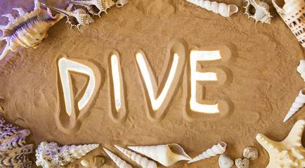 Dive symbol in the sand. Beach background. Top view