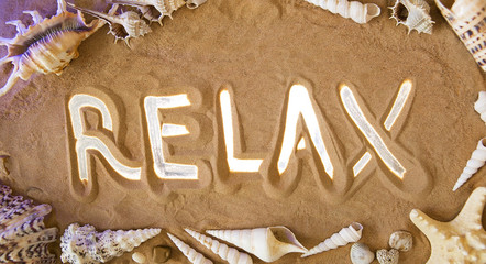 Relax symbol in the sand. Beach background. Top view