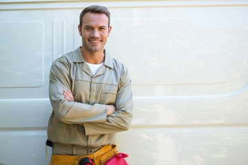 Handyman with tool belt around waist