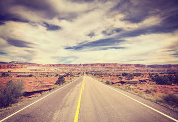 Vintage stylized picture of a scenic desert road.