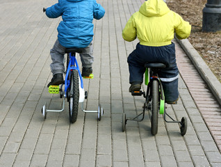 Children riding on bicycles.