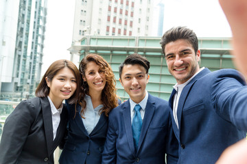 Group of business people take photo together