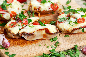 Cooked Mushrooms stuffed with cheese and plum tomatoes