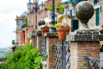 Beautiful flowers pots with blossoming flowers in scenic town of Nemi