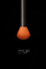 Makeup concept. Professional make-up brush isolated on black