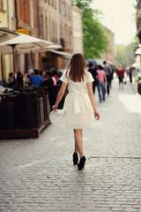 Cute girl posing on a city street