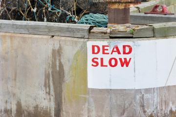 Harbour wall Dead Slow speed warning