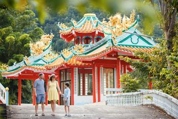 Family enjoying views of beautiful Chinese Temple on Koh Phangan island
