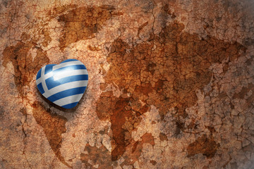 heart with national flag of greece on a vintage world map crack paper background