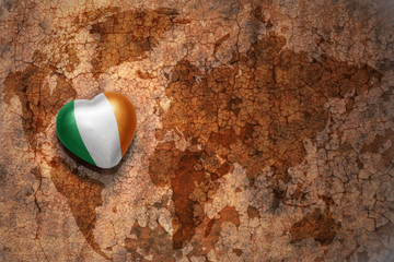 heart with national flag of ireland on a vintage world map crack paper background