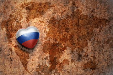 heart with national flag of russia on a vintage world map crack paper background
