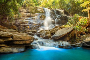 beautiful waterfall in green forest in jungle Chiang mai , Thail