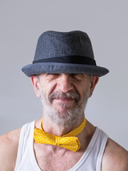 Funny senior man with a bow tie arround his neck