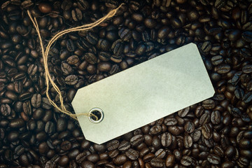 tag on the background of coffee beans