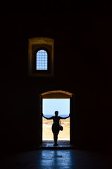 Silhouette of pretty girl in the doorway.