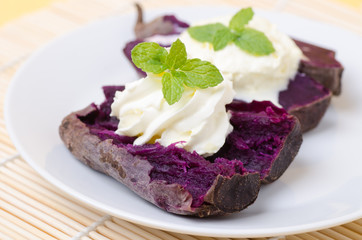 Purple sweet potatoes with whipping cream on top