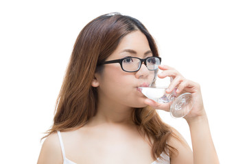 healthy woman drinking water on white background