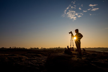 Silhouette of a young photographer during the sunset,sunrise