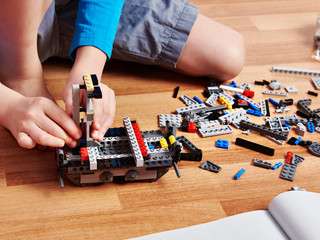 Child collects plastic building kit