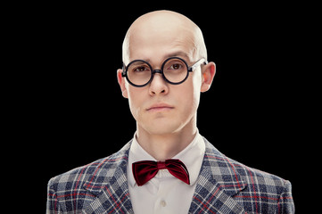 Young alluring bald caucasian man professor or teacher with red bow tie and glasses black isolated