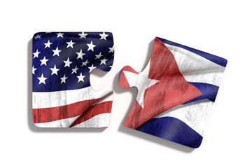 Cuban and American flags on puzzle pieces.