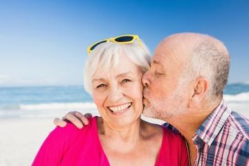 Senior man kissing wife