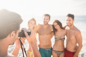 Man taking picture of his friends