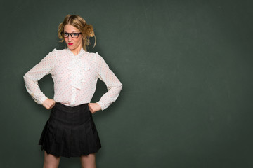 Geek nerdy girl showing strength in school education and learning smart nerd powerful intelligence space