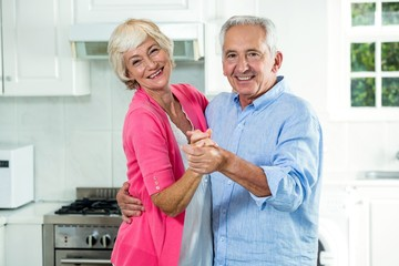 Portrait of happy senior couple dancing