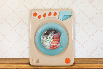 Washing machine in front of retro wallpaper