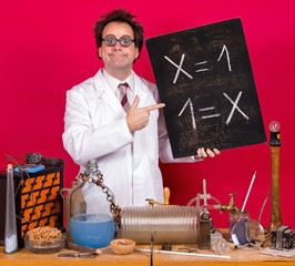 Professor in the laboratory shows a blackboard with mathematical formula