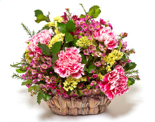 pink carnations in a wicker basket