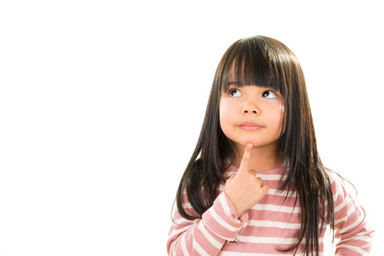 asian smiling little thoughtful girl isolated on white
