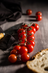 Close-up of a branch of tomatoes with bread