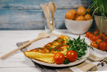 Omelet with ruccola and cherry tomatoes