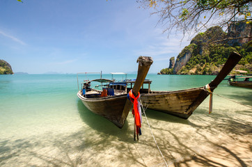Traditional boats in Thailand on a sunny day