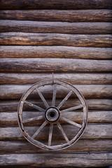 cart wagon old wheel on wooden wall
