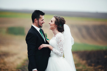 Bride is smiling to her groom