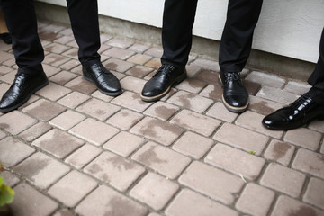 Black shoes of the groom and his best man