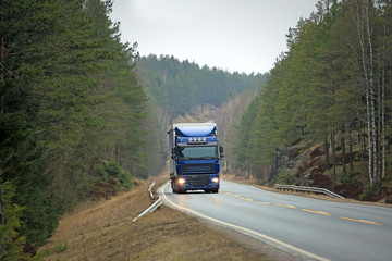 Blue Semi Truck on Forest Highway