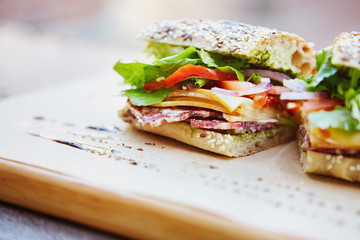 Keuken foto achterwand Snack Fresh sandwich with cheese, lettuce, salami and tomato