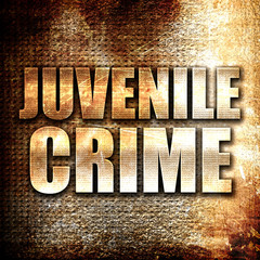juvenile crime, written on vintage metal texture
