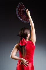 Woman with fan dancing dances