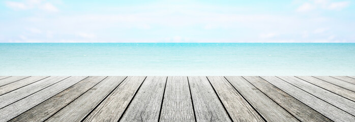 old long wood table top on blurred beach background / summer concept